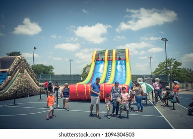 IRVING, TX, USA-MAY 19, 2018:Inflatable Bouncy Slide Bounce House tube at Children fun zone of Taste of Irving 2018 event. Outdoor festival featuring family-friendly activities, live music and food