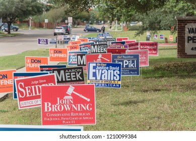 IRVING, TX, USA-OCT 22, 2018:Row of yard sign at residential street for primary election day in Dallas county, Texas, USA. Signs greeting early voters, political party posters for the midterm election