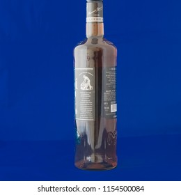 IRVING, TX, US-AUG 4, 2018:Close-up studio shot back view a bottle of Bacardi Black rum isolated on blue. Bacardi Limited is the largest privately held, family-owned spirits company in the world