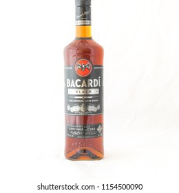 IRVING, TX, US-AUG 4, 2018:Close-up studio shot front view a bottle of Bacardi Black rum isolated on white. Bacardi Limited is the largest privately held, family-owned spirits company in the world