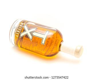 IRVING, TX, US-DEC 31, 2018:Studio shot lying down TX Blended Whiskey bottle isolated on white background. American blended whiskey from Firestone & Robertson Distilling Co. in Fort Worth