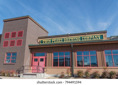 IRVING, TX, US-JAN 14, 2018: Facade exterior of Twin Peaks Brewing Company restaurant. A breastaurant, sports bar & grill chain with scratch food, ice cold beer, skimpily-dressed female waiting staff