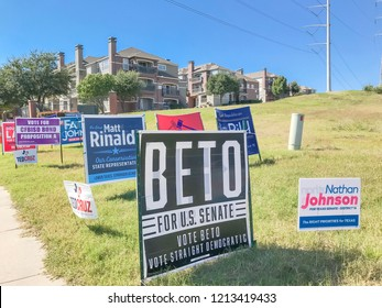 IRVING, TX, US-OCT 26, 2018:Row of yard sign at sidewalk pathway street for primary election day in Dallas county, Texas, USA. Greeting early voters, political party posters for the midterm election