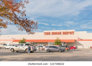 IRVING, TX, US-OCT 30, 2018:Customer enter Home Depot exterior storefront in autumn. A home improvement supply superstore, big-box that sells hardwares, construction products, tool rental services