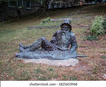 Irvington, NY / USA - October 1 2020: Bronze Statue of Rip Van Winkle on Main Street of Irvington NY near Town Hall and Main Street School based on the folk story by Washington Irving