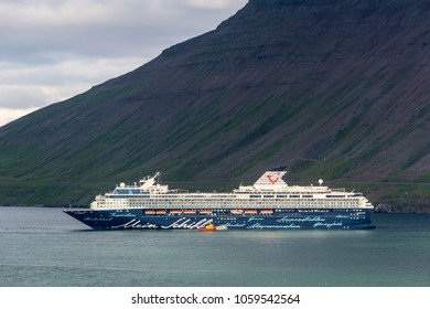 ISAFJORDUR, ICELAND - JULY 7, 2014: Mein Schiff 2 cruise ship of Tui Cruises company departing from Isafjordur, Iceland. Image was taken on July 7, 2014.