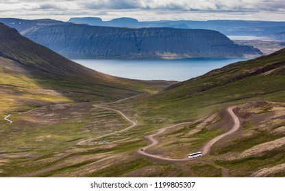 Isafjordur, West Iceland a bus driving through the serpentines over the fjords