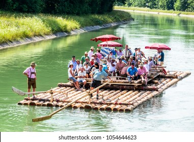 ISAR, GERMANY - JULY 10: typical bavarian raft ride on the river isar, a party with tradtional music on july 10, 2013