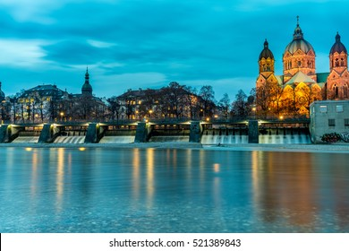 Isar River and St. Luke's Church at night in Munich. Saint Lucas Churchis the largest Protestant church in Munich