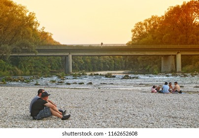 Isarauen, Germany  - AUGUST 21, 2018-Summer view of Isar river near Munich om sunset, the flowing waters are  clean, the place is ideal for relax  together with friends, hiking and camping