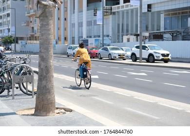 ISAREL - Tel Aviv, 27 June 2020: View of cyclist on Hayarkon Street, Tel Aviv, Israel, Middle East