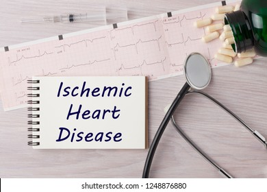 Ischemic Heart Disease (IHD) written on notebook with stethoscope, syringe and pills. Medical concept.