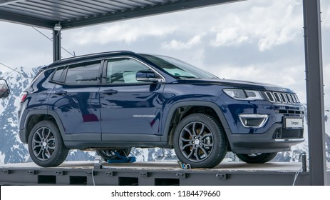 Ischgl, Austria - January 20, 2018: Dark blue Jeep Compass displayed at dramatic snowy mountain scenery