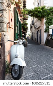 Ischia, Gulf of Naples, Campania Region, Italy, 10 August 2017: View of an iconic Italian scooter in an alley, Ischia, Gulf of Naples, Campania region, Italy