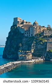 Ischia Island, Naples - Italy: The Castello Aragonese (Aragonese Castle), the iconic monument of Ischia, is a medieval city built on a small island and connected to the mainland by a stone bridge.