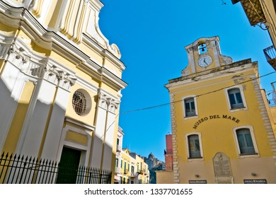 Ischia Island, Naples, Italy - February 17, 2019: The ancient fishing village of Ischia Ponte with a detail of the baroque cathedral of Ischia and the old Palazzo delle Posta
