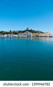 Ischia Island, Naples, Italy - March 24, 2019: The palaces, taverns and restaurants of the Rive Droite are reflected in the waters of the port of Ischia