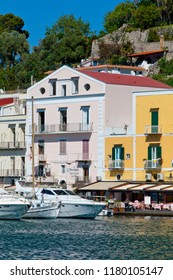 """Ischia Island, Naples, Italy  - May 3, 2015: the """"Riva Destra"""" of Ischia where restaurants and old taverns offers traditional italia sea food near sailboats moored in the harbour of Ischia Porto."""