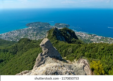 "Ischia Island, Naples - Italy: A stunning view of the Mediterranean Sea from the peak of Mount Epomeo at 789 metres in a clear summer day. At the bottom the lush vegetation of the forest ""Falanga"""