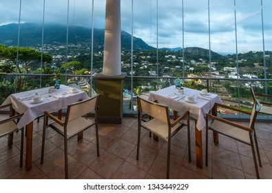 Ischia, Italy - July 5, 2015: Beautiful restaurant of the San Montano hotel with tables served for breakfast
