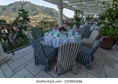 Ischia, Italy - July 5, 2018: Beautiful terrace of the San Montano hotel with tables served for dinner