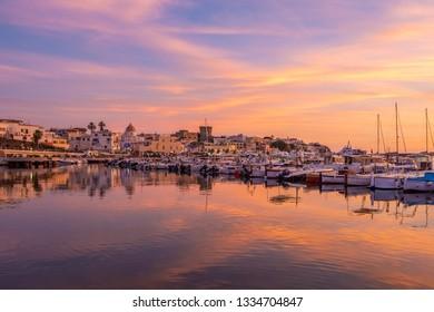 Ischia, Italy - June 20, 2017: Port Forio at sunset.