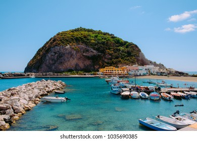 ISCHIA, ITALY, MAY 9 : fishing boats moored at Sant'Angelo and a hoteland hill on the background on May, 9, 2017. It's a small village within the comune of Serrara Fontana, Ischia, Italy.