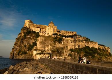 ISCHIA  (NA), ITALY - SEPTEMBER 20, 2012: sunset is enlightening Aragonese Castle on Ischia island