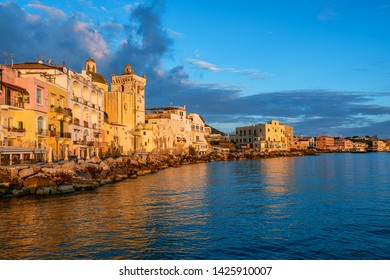Ischia town waterfront in warm sunset light, Ischia island, Gulf on Naples, Italy