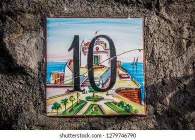 ISCHIA/ITALY - 05 JULY 2018: Vintage house sign number ten 10 painted on ceramic tile from Island Of Ischia, Italy