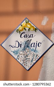 ISCHIA/ITALY - 05 JULY 2018: Vintage house sign painted on ceramic tile from Island Of Ischia, Italy