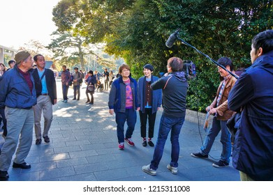 Ise, Mie Prefecture, Japan - November 28, 2015: famous Japanese TV personalities Haruna Kondo and Minowa Haruka walking around Ise,  entering Oharaimachi shopping street