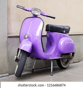 ISEO, ITALY, 14 OCTOBER, 2018 - Vespa scooter, italian transportation icon, parked on a street in Iseo, Italy, Europe
