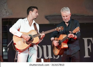 """ISEO,ITALY - AUGUST 28: Guitar players Andrea Valeri and Michael Fix at the event """"Acoustic Franciacorta 2015"""",28 August ,2015 in Iseo,Italy"""