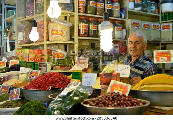 ISFAHAN - APRIL 19: Unknown man trades traditional iranian food and spices in market (Bazaar) in Isfahan, Iran on April 19, 2015. Bazaar is the most important tourist attraction in Isfahan, Iran.
