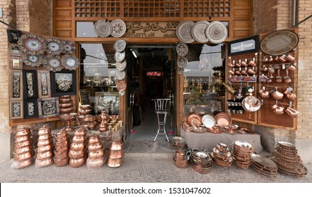 Isfahan, Iran - 2019-04-13 - Outside display of copper and silver wares of a small shop.