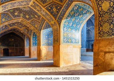 Isfahan, Iran - 23 October, 2018: Beautiful vaulted arch passageway at the Shah Mosque (Imam Mosque). Amazing Persian interior of the Muslim place. Colorful mosaic tiles. Islamic architecture.
