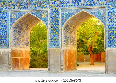 Isfahan, Iran - 23 October, 2018: Awesome arches covered with colorful mosaic tiles at courtyard of the Shah Mosque (Imam Mosque). Amazing Persian exterior of the Muslim place. Islamic architecture.