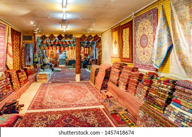 Isfahan, Iran - 24 October, 2018: Amazing inside view of carpet shop in the Grand Bazaar (Qeysarie Bazaar). Wide range of famous colorful Persian rugs. Fabulous traditional patterns and ornaments.