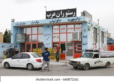 Isfahan, Iran - april 14, 2017: Tourists are walking next to a roadside cafe shop on the road from Isfahan to Yazd.