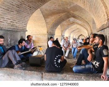 Isfahan, Iran - April, 2016. People in the arches under the Khaju Bridge in Isfahan, Iran.