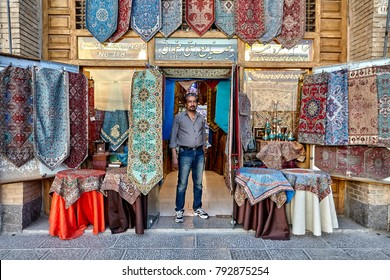 Isfahan, Iran - April 23, 2017: The seller of Iranian handicraft products is on the threshold of his store.
