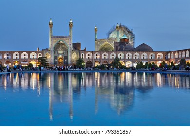 Isfahan, Iran - April 23, 2017: Evening view of the Safavid Shah mosque with night illumination and reflection in the water of a pond, Nagshe Jahan Square.