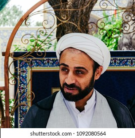 Isfahan, Iran - April 23, 2018: Portrait of a young Iranian Mullah wearing a keffiyeh in the courtyard of Jame Mosque