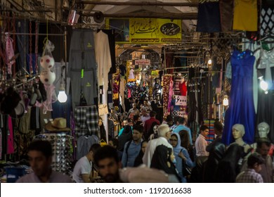 ISFAHAN, IRAN - AUGUST 20, 2018: Street of the Isfahan bazar in the evening, crowded and packed with people in the covered market. Symbol of the Persian architecture, it's a major landmark of the city