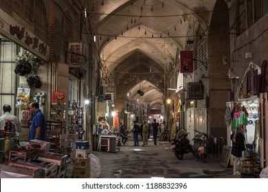ISFAHAN, IRAN - AUGUST 7, 2018: Street of the Isfahan bazar in the evening in a covered alley of the market. Symbol of the Persian architecture, it's a major landmark of the city