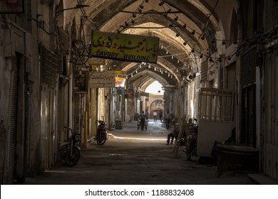 ISFAHAN, IRAN - AUGUST 7, 2018: Street of the Isfahan bazar in the afternoon, in a covered alley of the market. Symbol of the Persian architecture, it's a major landmark of the city