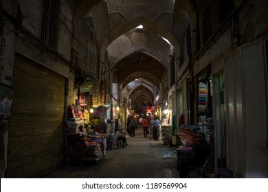 ISFAHAN, IRAN - AUGUST 8, 2018: Street of the Isfahan bazar in the evening in a covered alley of the market. Symbol of the Persian architecture, it's a major landmark of the city