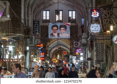 ISFAHAN, IRAN - AUGUST 8, 2018: Street of the Isfahan bazarw ith the portraits of the 2 Supreme leaders of the Islamic Republic of Iran, Ali Khamenei & Ruhollah Khomeini hung on the roof