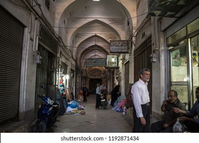 ISFAHAN, IRAN - AUGUST 9, 2018: Street of the Yazd Khan bazar in the evening in a covered alley of the market. Symbol of the Persian architecture, it's a major landmark of the city